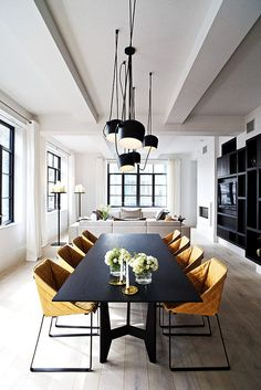 The chairs add lovely warmth to this otherwise cool space...they would also look fantastic in a vintage tan leather.