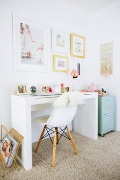 Bright feminine home office with a gallery wall