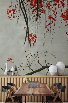 Bring some Eastern charm into your home with this flower wallpaper design. Cherry blossom branches drape into this interior to give a completely unique effect that is both stylish and modern. Pops of bright red give this mural a striking contrast that works beautifully with dining room spaces.