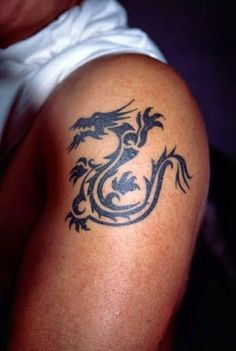 Dragon Tattoo # 95 - One of the most sought dragon tattoo idea for guys. Tribal dragon tattoo looks sexy on masculine arms of guys:) Dragon Tattoos For Men, Chinese Dragon Tattoos, Dragon Tattoo Designs, Tattoo Designs For Girls, Best Tattoo Designs, Tattoo Girls, Cool Tattoos For Guys, Tattoo You, Temp Tattoo