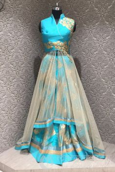 <p>You are emotional by your quality and ingenious by nature, your intuition and approach makes you special. Fascinating skyblue and beige colour having silk and net in readymade designer indowestern suit. Featured with pita and diamond work. Gives you a perfect look for party or an occasion or any festivals. Offered with matching bottom and dupatta.</p>