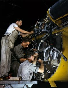"Shorpy Historical Photo Archive :: Big Bird With All the Trimmings: 1942 - July 1942. ""Wiring a junction box on the firewall for the right engine of a B-25 bomber at the North American Aviation plant in Inglewood, California. Forward of this wall will be mounted one of two 1,700-horsepower Wright Whirlwind engines."" 4x5 Kodachrome transparency by Alfred Palmer."