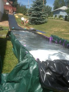 Homemade slip and slide- greatest fun of the summer Jessica lim look at this!!