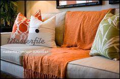 Orange sofa Throws