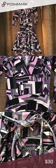 Geometric Patterned Stretch Dress Purple, black, and white patterned dress with deep V neckline and wide waistband. 3/4 length sleeve. Lots of clothes in my closet, bundle and save! Alyn Paige Dresses