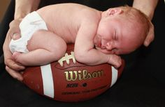 a boy and his football when we have a baby:  packers jersey + football + this pose = great pic