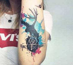 3 colors abstract tattoo style of Expecto patronum motive done by artist Ilaria Art | Post 20705 | World Tattoo Gallery - Best place to Tattoo Arts