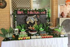 Jurassic Park birthday party dessert table! See more party planning ideas at CatchMyParty.com!