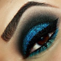 Super sexy drama! Stacey Rios used Sugarpill Afterparty and Bulletproof, MakeupGeek and NYX glitter to create this incredible eye. Perfect for a night out!