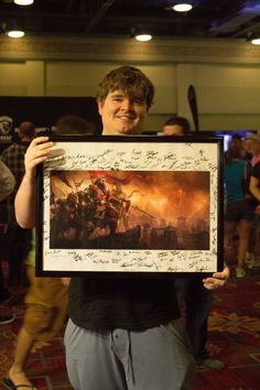This lucky QuakeCon 2014 attendee won a signed ESO Ebonheart Pact lithograph at the Dallas Pets Alive booth.