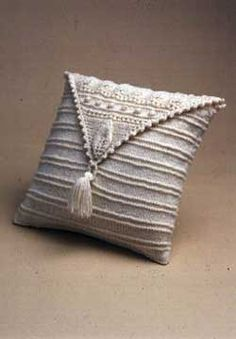 Beautiful pillow with a triangular aran panel. Shown in Patons Decor.
