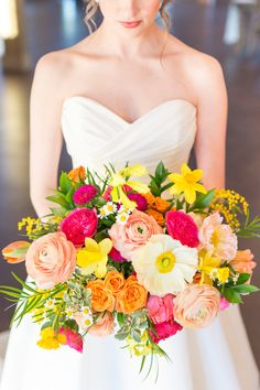 Bridal Bouquet of yellow, pink, and orange spring flowers by Lark Floral