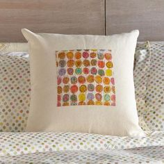 SUNLIGHT CIRCLES PILLOW - Indian textile designer Neeru Kumar fashioned this exquisite pillow exclusively for Sundance using pieces of vintage saris to create colorful circles of light.