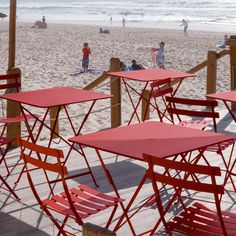 Fermob bistro chairs and tables in poppy red. @bistrofurniture