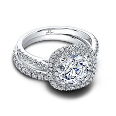 The Teagan & Tracie Set: (ring 0.47 ttl; band 0.11 ttl) Something old, something new. The Teagan and Tracie Wedding Set is the perfect symbol of your evolving love. A glamorous diamond halo evokes the excitement of a movie-star glamorous past, yet its rounded square shape feel very au courant. And the fishtail set pavé diamonds give off a radiant light. Can be custom made to fit any shape center stone. Hand crafted in either Platinum, 18K Gold or 14K Gold.