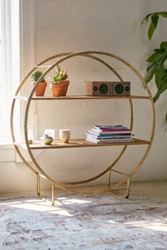 As a room divider... Brigid Circle Shelf - Urban Outfitters