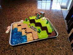 made a minecraft cake for my little brother's birthday! chocolate cake, homemade rice krispy treats, jell-O, and his favorite minecraft legos :)