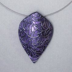 Items similar to Viking-inspired Large Purple Shield Necklace Handmade Lightweight on Etsy Polymer Clay Pendant, Polymer Clay Art, Polymer Clay Jewelry, Metal Clay, Clay Ideas, Rock Art, Handmade Necklaces, Diy Art, Vikings