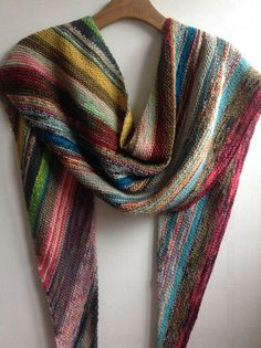 Free Knitting Pattern for Scrappy Bias Shawl - Garter stitch shawl knit on bias to create asymmetrical triangle shape with color changes. Perfect for scrap fingering / sock yarn or mini skeins. Designed by Emily Clawson, Pictured project by janehunter8