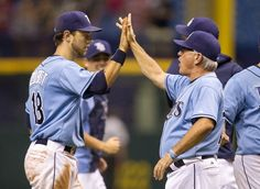 Rays manager Joe Maddon, high-fiving Ben Zobrist, says he wishes the Tigers Miguel Cabrera wouldn't cry so much. (Some of his comments on Porcello's intentional hit of Zobrist in the 1st inning.) Rays got final say on emotionally charged weekend series by winning 3 - 1 & winning the series. Sunday's win was a product of strong pitching by Hellickson, a couple of clutch hits & shutdown relief work. (6-30-13)