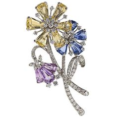 Gumbiner Diamond, Sapphire and Platinum Flower Brooch | From a unique collection of vintage brooches at https://www.1stdibs.com/jewelry/brooches/brooches/