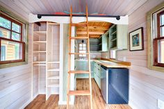 A tiny house on wheels in Asheville, North Carolina. Photos taken by Chris Tack at Tiny House Conference. Built by Wishbone Tiny Homes.