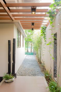Contemporary Filipino furniture, natural materials, and a design that lets the sun and air in complete this tropical home Modern Tropical House, Tropical House Design, Small House Interior Design, House Gate Design, Tropical Houses, Small Modern House Exterior, Modern Houses, Modern Filipino House, Modern Filipino Interior