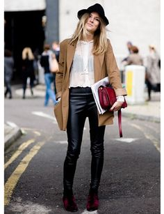 street style. leather pants + white sheer blouse + hat + long coat.