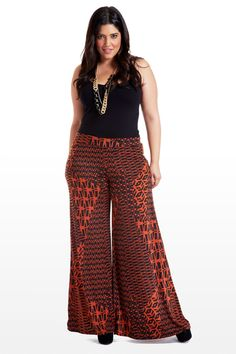 You know I'd totally wear these.    Add sophistication to your fall collection with wide-leg pull-on pants that boast a daring Aztec-meets-tribal print. Pocketless with side seams and a wide waistband, these bottoms don't sacrifice comfort for style. Pair with a simple black top or cropped jacket; play off the burnt red when accessorizing.