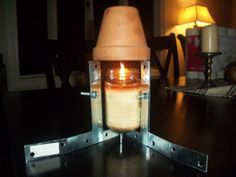 When the heater goes out in your home you can go into the garden and get some old pots and a candle and make a heater!