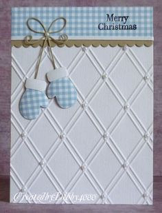 Sweet gingham mittens are dangling from a scalloped border.  The embossed base has pearl accents for a lovely non-traditional handmade Christmas card.