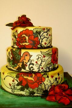 A tattoo themed wedding cake would be way cool.   tattoo themed wedding cake by fairycakes and faces, via Flickr