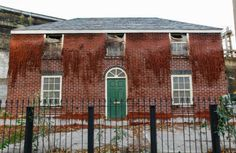 Alex Chinneck's life-size house of wax