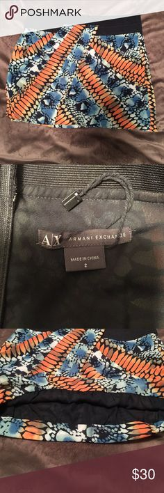 Armani Exchange Skirt Gently used! Awesome pattern. Slimming waist and high hem. Gives bubble effect! A must to add to your Armani collection! Armani Exchange Skirts Mini