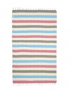 """Ibiza is an ultra soft and lightweight """"hammam"""" towel, weaved entirely in traditional hand looms. The zic-zac pattern along with its bold colored stripes, makes this a unique and all purpose accessory for the beach or travel. Highly absorbent and quick to dry, this can be used as a beach towel, beach mat, sarong or cover up"""