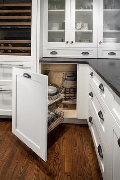 Gilday Renovations: White Shaker style cabinetry with floating door hinges. Built-in refrigerator with ...