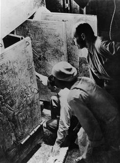 British archaeologist Howard Carter (left) and his assistant Arthur Callender (right) opening the entrance to the fourth chamber of Tutankhamen's tomb,  1923