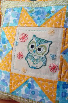 Clover and Violet - Owl Embroidery in a Star Quilt Block on a Pillow.