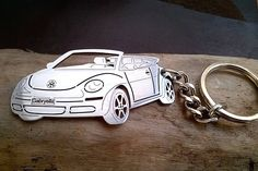 Custom made VW Beetle cabriolet keychain.  M A T E R I A L S  • Made from stainless steel 1,2mm by laser cutting and engraving. First grade of stainless steel, polished edges.  H O W ∙ T O ∙ P E R S O N A L I Z E  • We can put your text on the licence number plate or/and the door. Just write us the text for personalisation in orders detail or in conversation - its FREE !  • We can make the key chain with your cars rims - just send us a photo - its FREE !  C O L O R  • Primary color is SI...