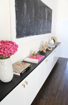 floating credenza made with Ikea Akurum Cabinets & glossy white doors.