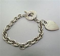 Tiffany & Co. Sterling Heart Charm Bracelet.  Available @ hamptonauction.com for the March 16, 2014 auction!