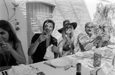 We love a long Summer lunch; this would have been fun! Alain Delon and Brigitte Bardot in Saint-Tropez, 1968.