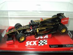 SCX F1 Lotus Renault R31- SCX Lotus Renault GP R31 F1 Nick Heidfeld 2011 Formula One #9. Heidfeld's Lotus Renault GP 1/32 scale model F1 slot car by SCX will give you some great electric Formula 1 slot car track action and is fitted with Magnatraction, front wheel steering with free wheeling front wheels, self-centering easy change sprung guide, tilting engine cradle to allow body roll, and displayed in a clear crystal case for your…