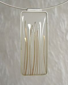 Carla Pennie Mcbride seed pendant of sterline, gold fill and resin: