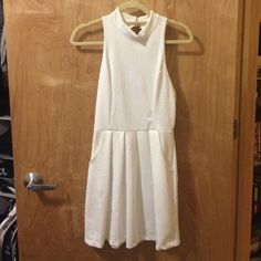 Closet clear out! Urban Outfitters dress w/cutout Very pretty white dress with floral embossed fabric, high neck, and cutout back. Also has pockets! Very comfy material and very flattering. Looks somewhat fancy, but can dress down, but feels more comfy like a sun dress! Fits like a snug M or a looser S. From Urban Outfitters. Very clean, never worn except to try on. Great condition. Offers welcome!! No trades. silence + noise Dresses