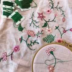"""Making incremental progress on this large piece. I shared an image of it in its early stages a few weeks ago. It's going to be a 10"""" x 10"""" pillow and I'm moving out of my comfort zone by creating some larger, intricate flowers in a limited color palette. #happycactusembroidery #dspink"""