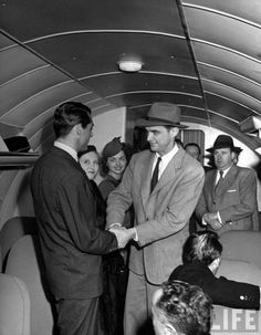 Howard Hughes Greeting Cary Grant Aboard Plane as He Prepares to Take Movie…
