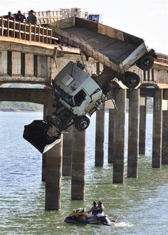 A truck teeters from the side of the Chavantes bridge near Fartura, Brazil, on September 22, 2012, after the driver crashed through the guard railing. No injuries were reported and the trucker escaped unharmed.