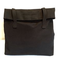 Donna Karan New York Handbag Great condition. Fold over flap. With Velcro closure. Nylon with inside in great condition as well. Shoulder strap drop is 6 inches. Deep inside. 14 x 10 inches tall. Donna Karan NY Bags