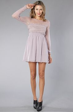 the dobby dot lace on this dress is so sweet. plus it looks comfy. Free People, Vintage Lace Dress in lavendar, $168.